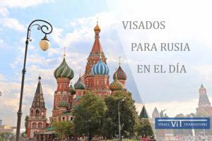 Publicidad de Visados para Rusia en el día con foto edificio ruso